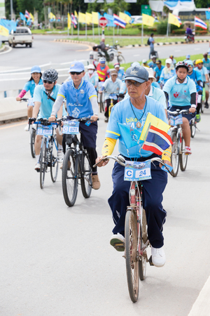 singburi: CHIANGRAI AUGUST 16 : Unidentified people cycling in Bike for mom, event show respected to Queen of Thailand on Chiangrai 16, 2015, Singburi, Thailand.