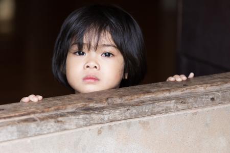 sch�ne augen: Closeup adorable face little asian girl have beautiful eyes after cry.