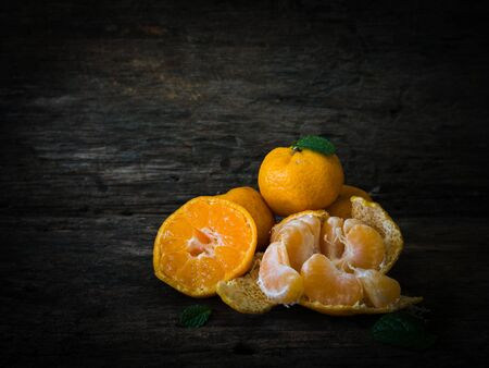 excretion: Still life oranges fruit on texture wood. The orange has more  utility  for example diet , relax from smell  peel or excretion.
