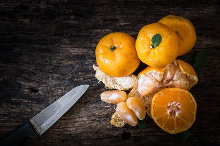 excretion: Still life oranges fruit and knife on texture wood. The orange has more  utility  for example diet , relax from smell  peel or excretion. Stock Photo