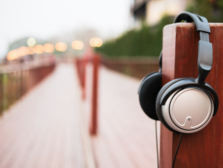 impassioned: Headphone with sunlight on walk way wood