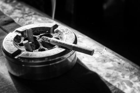 Cigarette on stainless ashtray. on moring light.