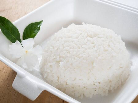 foam box: Jasmine rice in foam box with plastic Spoon and fork. Stock Photo