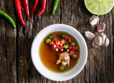 ferment: Thai fish sauce three taste. is made from real  ferment fish , lemon and garlic. have fragrant smell and three taste sweet, salty and sour, it popular Side dish any thai food.