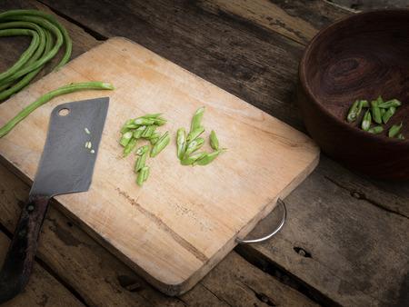 Stil: stil life yardlong bean slice on Chopping board wood. Stock Photo