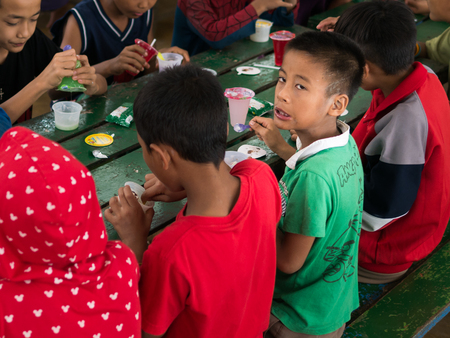orphanage: CHIANGRAI, THAILAND - August 12, 2016: Unidentified child orphans in Ban nana  house. Ban nana Orphanage take care children from Tribal Problem family.