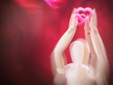 Still life wooden puppet and pink heart. concept everyting have love and heart. with effect zoom out.
