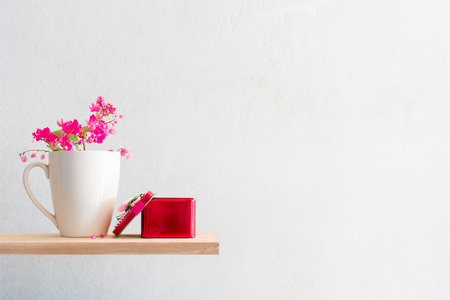 pink dolphin: The red gift with white mug coffee and the Antigonon leptopus  flower. Stock Photo