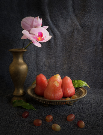 Still life rose apple, Orchid  and Burning leaves in concept nature is not perfect.