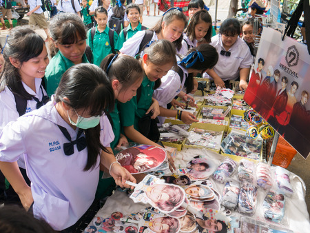 CHIANG RAI, THAILAND - MAY 21, 2017 : Asian student girls crazy about and buy souvenir South Korea actor.