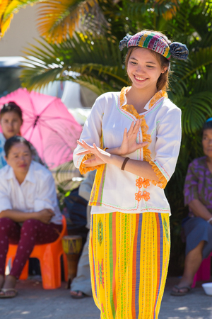 CHIANGRAI -THAILAND NOVEMBER 21: Unidentified Tai Lue women (ethnic group living in parts Thailand) in Tribal dress show folk dance  at on November 21, 2015 in Chiangrai,Thailand