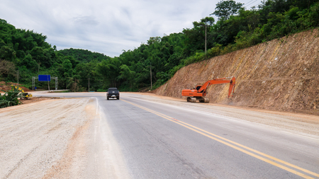 Construct Expand  road in  forest and Mountain. Stock Photo
