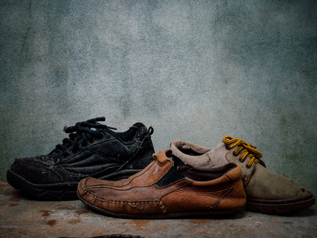 Still life old Leather shoes and belt. It more of dirty and  shabby skin. Time to change new shoes or repair.