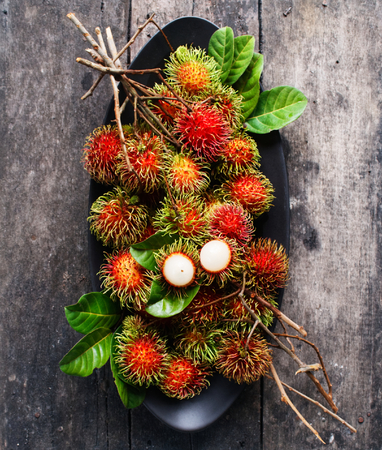 fresh rambutan with green leaf.