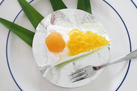 Gold Egg Yolk Thread Cakes and Pandan or thai Language call cake bai tey foi thong. Foto de archivo - 111019144