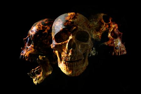 Head skull in flame on dark black background. the symbol of dead. Foto de archivo - 122610127