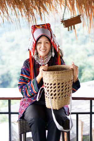 Asian woman in the tribe dress be smile happy with coffee seed 版權商用圖片 - 122540200