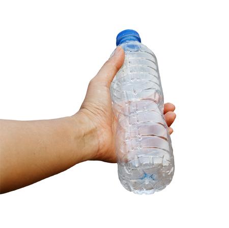 Hand holding empty bottle on isolated Foto de archivo - 122519471