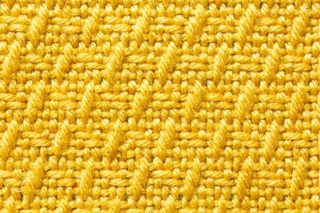 A Yellow tablecloth texture on the table in the kitchen Stock Photo