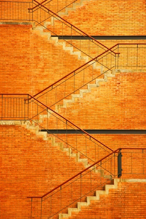 The staircase and brick brown wall texture