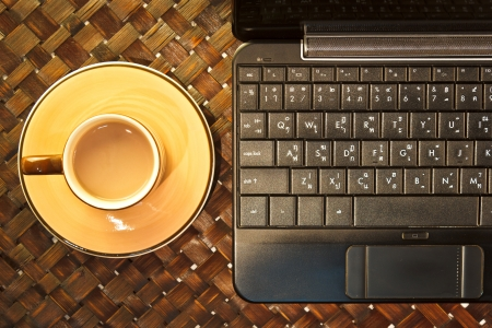 Coffee cup on laptop  Above view Stock Photo - 21920229
