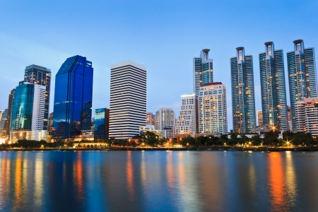 Twilight cityscape, office buildings and apartments in Thailand at dusk  View from public park Stock Photo - 22709825