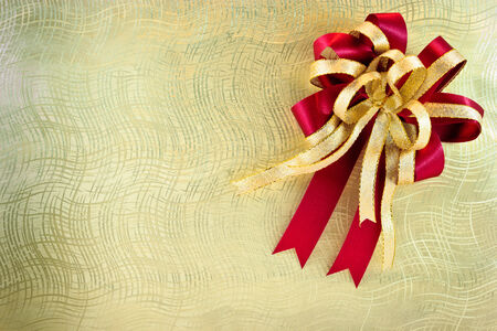 Golden texture on gift box with ribbon photo