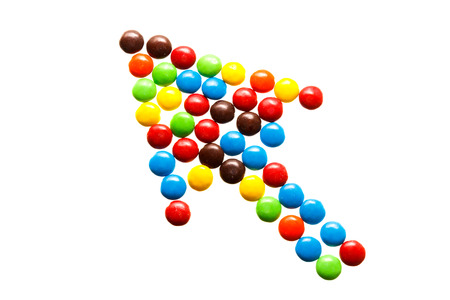 Close up of a pile of colorful chocolate coated candy, Arrow shape