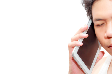 Asia man holds his smart phone near his ear and listening photo