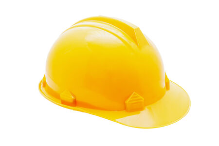 Isolated yellow hard hat on white background Stock Photo