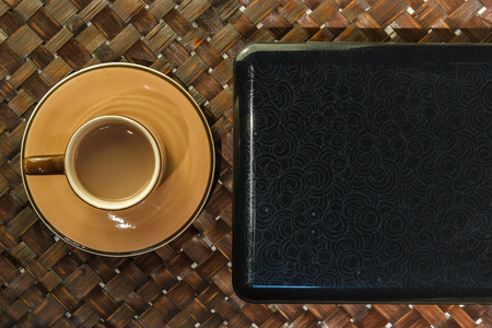 Coffee cup on laptop. Above view. photo