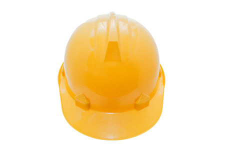 Isolated yellow hard hat on white background photo