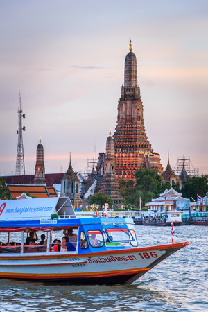 Bangkok Thailand August 17 - Wat arun with Chao Phraya Express Boat on August 17, 2014 in Bangkok Thailand. Wat Arun, Temple of Dawn is a Buddhist temple in Bangkok Yai district of Bangkok, Thailand, on the Thonburi west bank of the Chao Phraya River. Editorial
