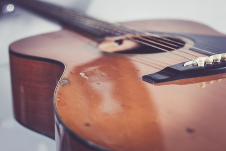 middle joint: Old acoustic guitar Stock Photo