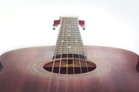 Acoustic guitar isolated on white background photo