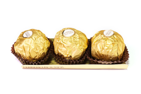 ferrero: Bangkok Thailand - December 31: Ferrero Rocher Chocolates on a white background.