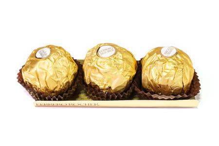 ferrero: Bangkok Thailand - December 31: Ferrero Rocher Chocolates on a white background.