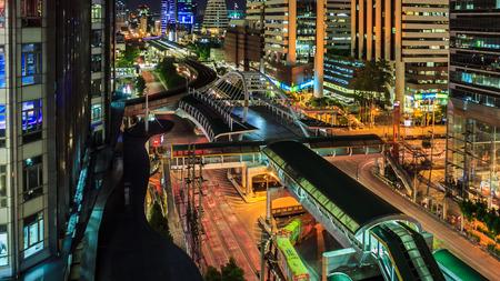 Bangkok city, Chong Nonsi skywalk. Logos and trademarks digitally obscured.