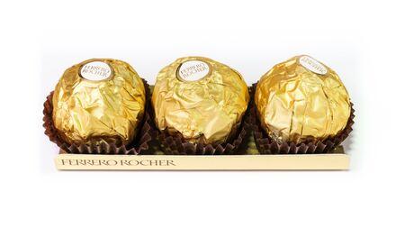 ferrero: Bangkok Thailand - December 31: Ferrero Rocher Chocolates on a white background on December 31, 2014 at Bangkok Thailand. Stock Photo