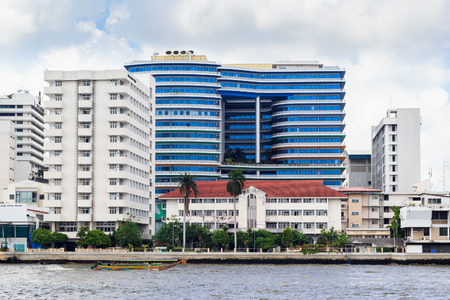 west river: Bangkok - February 21, 2015: Siriraj hospital is the first hospital and medical school in Thailand, located at the West bank of Chao Phaya river in Bangkok.