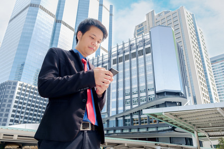 Portrait of an handsome businessman using smartphone