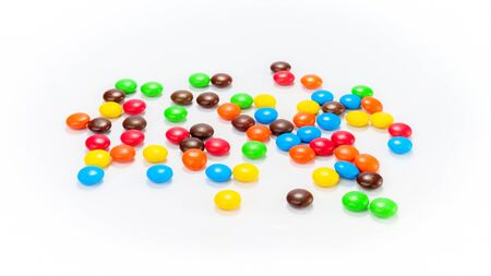 lots of: Lots of colorful candies spread on white background
