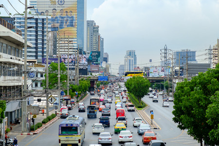 congested: Bangkok, Thailand - June 3, 2015: Traffic moves slowly along a busy road on June 3, 2015 in Bangkok, Thailand. Annually an estimated 150,000 new cars join the already heavily congested streets of Bangkok.