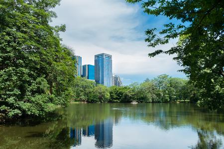 city park skyline: City park under blue sky with Downtown Skyline in the Background