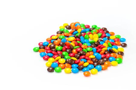 lots: Lots of colorful candies spread on white background