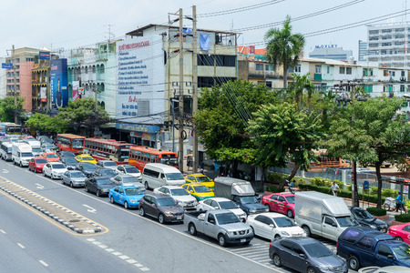 congested: Bangkok - April 29: Traffic moves slowly along a busy road on April 29, 2015 in Bangkok, Thailand. Annually an estimated 150,000 new cars join the already heavily congested streets of Bangkok.