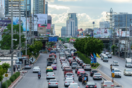 gridlock: Bangkok - August 21, 2015: Traffic moves slowly along a busy road on August 21, 2015 in Bangkok, Thailand. Annually an estimated 150,000 new cars join the already heavily congested streets of Bangkok.