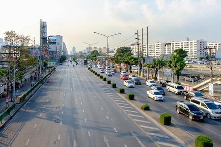 Bangkok, Thailand - February 1, 2016: Traffic moves slowly along a busy road in Bangkok, Thailand. Annually an estimated 150,000 new cars join the already heavily congested streets of Bangkok.