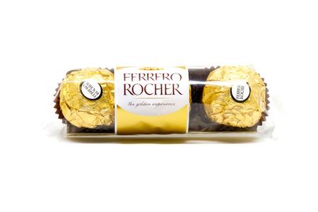 ferrero: Bangkok Thailand - February 9: Ferrero Rocher Chocolates , select focus on a white background on February 9, 2016 in Bangkok Thailand.