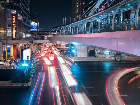 bangkok landmark: Bangkok, Thailand - January 6, 2016: Sky walker at the center connected to electric train station colorful in night bangkok city
